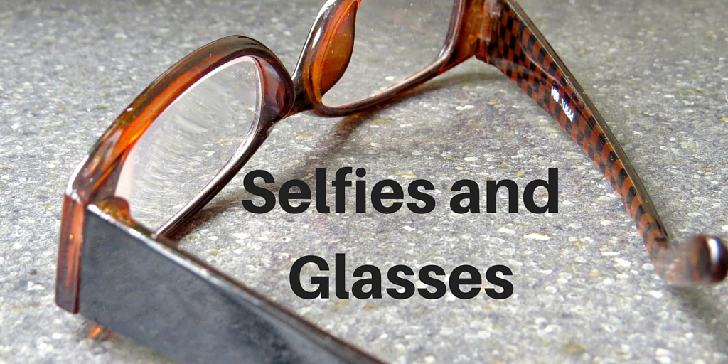 Pair of glasses on work surface - Selfies and glasses